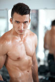 Strong guy in the gym — Stock Photo