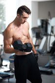 Man doing exercises dumbbell bicep muscles — Stock Photo