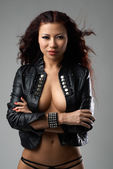 Beautiful asian woman naked in a leather dress — Stock Photo