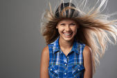 Girl wearing a hat laughing and her hair flutter — Stock Photo