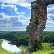 Stock Photo: Ruined castle on high hill in woods and rivers