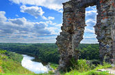 Ruined castle on a high hill in the woods and rivers — Stock Photo