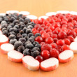 Frozen cranberries and blackberry are laid out in the form of heart close-up — Stock Photo