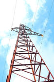Electric pillar.Electrical steel support covered with rust in the sky — Stock Photo