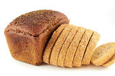 Bread.A loaf of rye bread topped with coriander seeds and sliced wheat bread with bran — Stock Photo