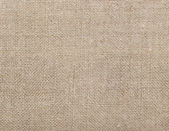 Textile background.Old rustic homespun cloth as background — Stock Photo