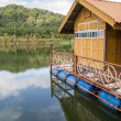 House on raft in the lake — Stockfoto