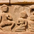 Ancient Khmer lintel carved with a kala demon figure sitting on — Stock Photo