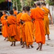 Close up of group of young Buddhist novice monks walking — Stock Photo #33851263