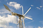 Windmills against a blue sky, alternative energy source — Stock Photo