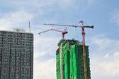 Construction site with crane and building — ストック写真