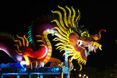 Chinese style dragon statue at night — Stock Photo