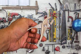 Locking pliers in hand tool background. — Stock Photo