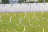 Background of football net on a green grass — Foto de Stock