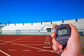Stopwatch in athletics field — Stock Photo