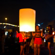 CHONBURI, THAILAND - NOVEMBER 28: Two people holding a flying fire lantern to celebrate the Loy Krathong festival. November 28, 2012 in Hua Hin, Thailand. — Stock Photo