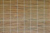 Bamboo curtain on the windows — Stock Photo
