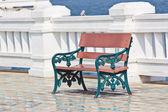 Stylish bench in summer sea — Stock Photo
