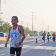 Stock Photo: CHONBURI, THAILAND - DESEMBER 16: Unidentified runner competes o