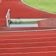 Hurdles on the red running track prepared for competition. — ストック写真