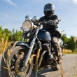 Biker on the road against the sky — Stock Photo