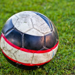 Stock Photo: Soccer ball on green grass