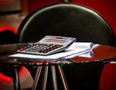 Table and the calculator — Stock Photo