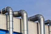 Ventilation pipes of an air conditionon a roof top. — Stock Photo