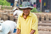 Man laborer lifts the wood of Production of bricks in thailand — Stock Photo