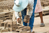 Woman laborer is dislocating a brick of Production of bricks in — Stock Photo