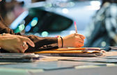 Businesswoman writing with pen — Stock Photo