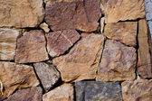 Elegant stone wall from small square parts — Stock Photo