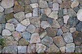 Parede de pedra elegante de pequenas peças quadradas — Foto Stock