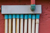 Wall with pipe painted and decorated — Stock Photo