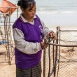 Womfishermen is weaving fish-trap — Stock Photo #37739607