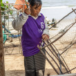 Womfishermen is weaving fish-trap — Stock Photo #37739619