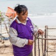 Womfishermen is weaving fish-trap — Stock Photo #37739631
