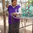 Womfishermen is weaving fish-trap — Stock Photo #37739657
