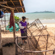 Womfishermen is weaving fish-trap — Stock Photo #37739663