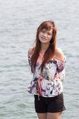 Asian woman on tropical beach — Foto de Stock
