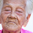 Portrait of a worried old woman with a sad expression — Stock Photo
