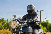 View of a man with a motorcycle on a asphalt road. — Stock Photo
