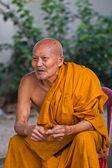 Thai monk sits to smile — Stock Photo