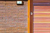 Modern door in new brick wall — Stock Photo