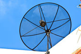 Satellite dish on top roof — Stock Photo