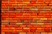 Surface of red regular brick wall texture — Stock Photo