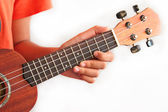 Girl playing Ukulele , close up in hands — Stock Photo