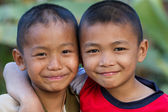 Two little friends hugging each other — Foto Stock