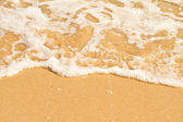 Soft wave of the sea on the sandy beach — Stock Photo
