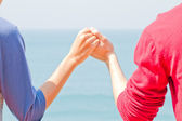 Two hands over thai sea — Stock Photo